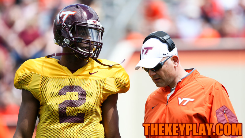 QB Dwayne Lawson talks to head coach Justin Fuente during a break in the action. (Mark Umansky/TheKeyPlay.com)