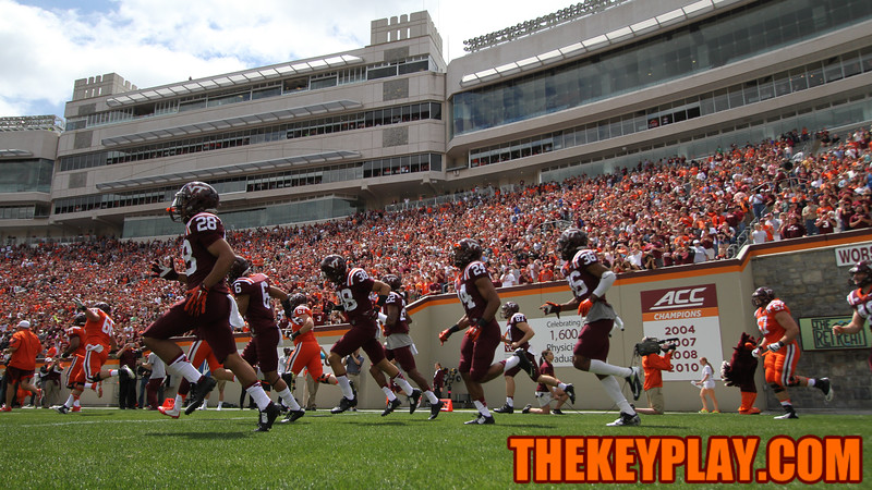 The Hokies run onto the field before the start of the spring game. (Mark Umansky/TheKeyPlay.com)