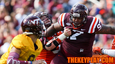 DT Tim Settle (97) has eyes on the quarterback on a rush late in the game. (Mark Umansky/TheKeyPlay.com)