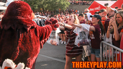 Virginia Tech fans react as the Hokiebird walks by during the Hokie Walk before gametime. (Mark Umansky/TheKeyPlay.com)