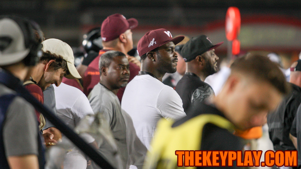 Former Virginia Tech and NFL QB Michael Vick stands on the Hokies' sideline during the game. (Mark Umansky/TheKeyPlay.com)