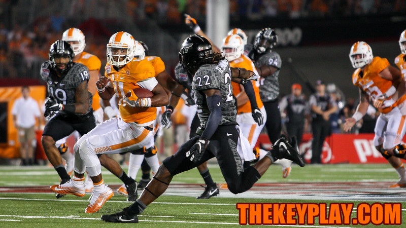 Tennessee QB Joshua Dobbs (11) looks to avoid a tackle by Terrell Edmunds (22). (Mark Umansky/TheKeyPlay.com)