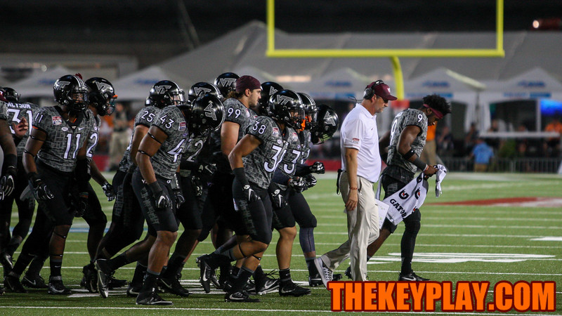 Virginia Tech defensive coordinator Bud Foster (white) leads his unit off the field at the start of the fourth quarter. (Mark Umansky/TheKeyPlay.com)