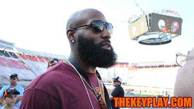 Former Hokies and current Washington Redskins safety DeAngelo Hall speaks with reporters before the stadium opens to the public. (Mark Umansky/TheKeyPlay.com)