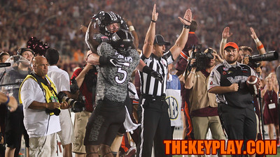 Sam Rogers and Cam Phillips celebrate the team's opening touchdown. (Mark Umansky/TheKeyPlay.com)
