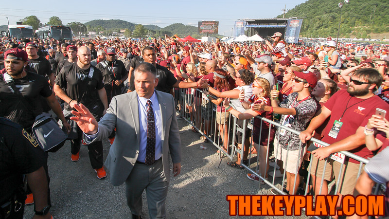 Virginia Tech head coach Justin Fuente leads the team on the Hokie Walk outside the stadium as evening approaches. (Mark Umansky/TheKeyPlay.com)