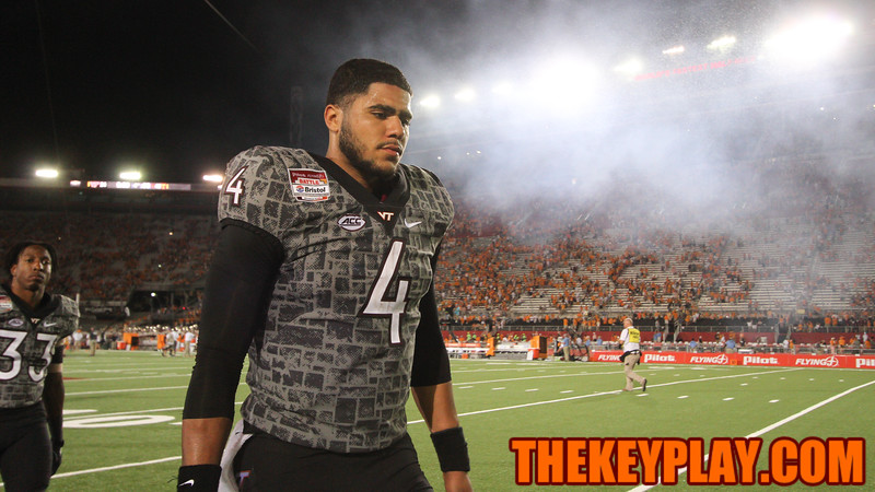 QB Jerod Evans walks off the field at the end of the game. (Mark Umansky/TheKeyPlay.com)