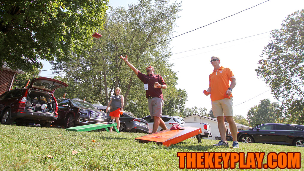 Virginia Tech and Tennessee fans play cornhole outside the stadium while tailgating before kickoff. (Mark Umansky/TheKeyPlay.com)