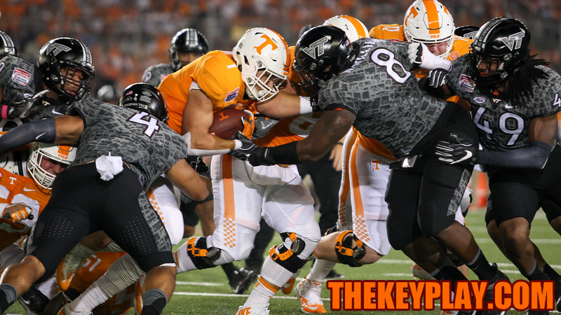Tennessee RB Jalen Hurd runs hard with the ball right into the Hokies' defense in the second quarter. (Mark Umansky/TheKeyPlay.com)