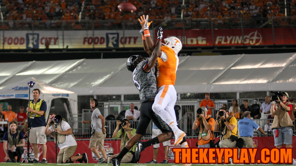 Vols WR Jauan Jennigs outleaps VT's Greg Stroman for Tennessee's first touchdown of the game. (Mark Umansky/TheKeyPlay.com)