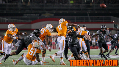 Tennessee QB Joshua Dobbs (11) fires off a pass before Virginia Tech DT Nigel WIlliams can get to him for a sack. (Mark Umansky/TheKeyPlay.com)
