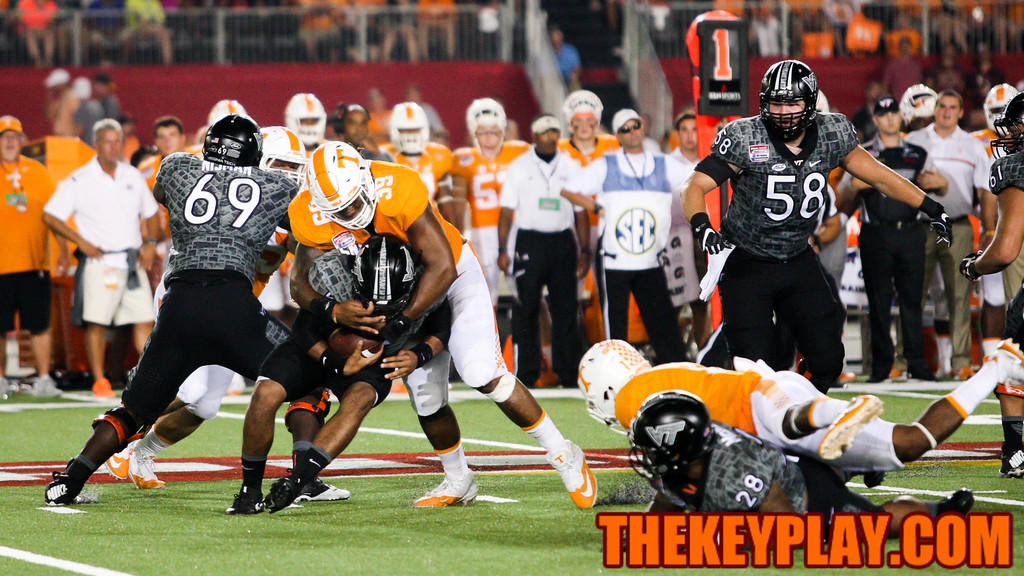 VT QB Jerod Evans is sacked by Tennessee's Kendal Vickers. (Mark Umansky/TheKeyPlay.com)