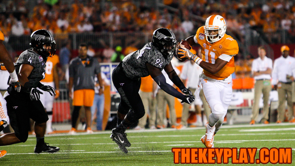 Joshua Dobbs evades another tackle by Trevon Hill (94) before firing off a pass in the fourth quarter. (Mark Umansky/TheKeyPlay.com)