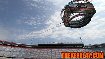 Colossus, the new big screen installed at Bristol Motor Speedway, hangs above the field as workers make final preperations for the game. (Mark Umansky/TheKeyPlay.com)