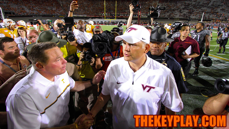 Virginia Tech head coach Justin Fuente (right) congratulates Tennessee head coach Butch Jones (left) after the final whistle. (Mark Umansky/TheKeyPlay.com)