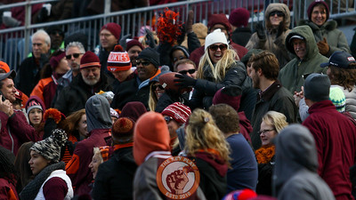 A fan in the South endzone catches a Virginia Tech kickoff that sailed through the back of the endzone. (Mark Umansky/TheKeyPlay.com)