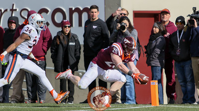 Sam Rogers dives for the pylon to score his second touchdown of the day. (Mark Umansky/TheKeyPlay.com
