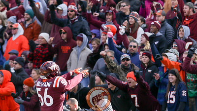 Sean Huelskamp points at the South endzone crowd after a Virginia Tech kickoff goes for a touchback. (Mark Umansky/TheKeyPlay.com