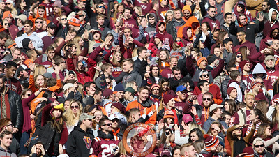 Students in the North endzone stands dance during a media timeout. (Mark Umansky/TheKeyPlay.com