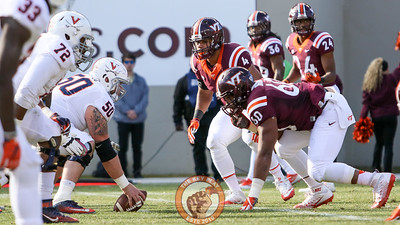 Ken Ekanem (4) and Woody Baron (60) line up against the UVa offensive front. (Mark Umansky/TheKeyPlay.com)