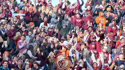 Students in the North endzone stands celebrate a pick-six. (Mark Umansky/TheKeyPlay.com)