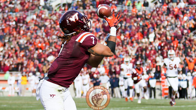 Bucky Hodges reaches up to catch a touchdown for the Hokies. (Mark Umansky/TheKeyPlay.com)