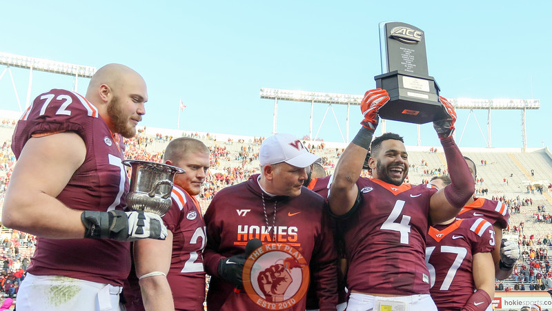 Ken Ekanem holds up the ACC Coastal Division champion trophy. (Mark Umansky/TheKeyPlay.com)