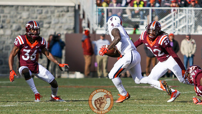 Adonis Alexander (36) and Terrell Edmunds (22) square up to tackle UVa's Taquan Mizzell. (Mark Umansky/TheKeyPlay.com)