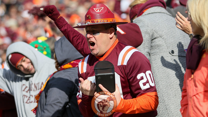 A Virginia Tech fan celebrates in the East stands during a break in the action. (Mark Umansky/TheKeyPlay.com)