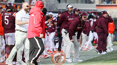 The Virginia Tech coaching staff looks on during the third quarter. (Mark Umansky/TheKeyPlay.com)