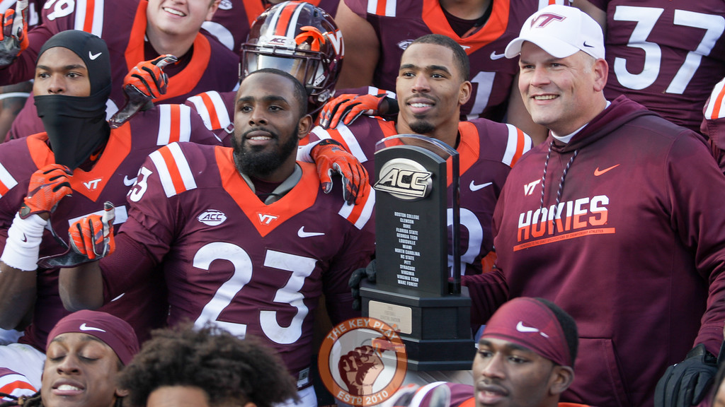 Head coach Justin Fuente poses with his team and the ACC Coastal trophy after the end of the game. Virginia Tech defeated Virginia 52-10 to keep the Commonwealth Cup in Blacksburg for another year. (Mark Umansky/TheKeyPlay.com)