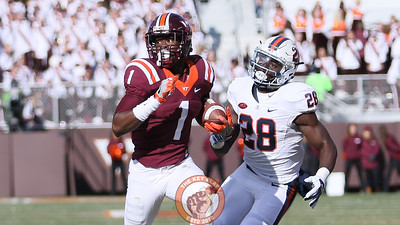 Isaiah Ford runs with the ball as UVa's Wilfred Wahee chases close behind. (Mark Umansky/TheKeyPlay.com)