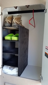 Home-built shelves to hold shoes and whatnot.