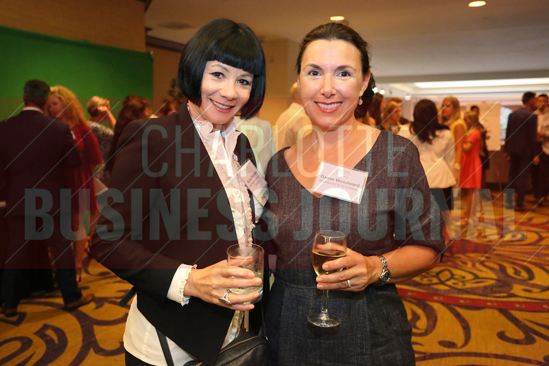 Nicole Merl and Danae Woodward pose for a photo at the Women in Business awards.