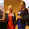 Attendees pose for a photo at the Women in Business event on Thursday.