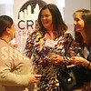 Nicole Green and Jennifer Yoxtheimer network at the Crew Charlotte table.