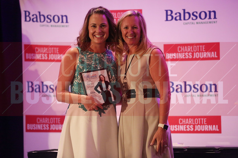 Cheryl RIchards of Northeastern University-Charlotte presents Nancy Eddins with her Women in Business award.