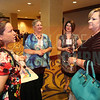 Elaine Piraneo and Crystal Cliff network during the cocktail reception.