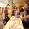 Attendees visit the Crew Charlotte table.