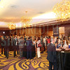 Attendees network and enjoy the cocktail reception during the Women in Business event at Hilton Center City on Thursday.