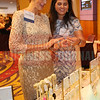Winner Susan McGuire of Foundry Commercial shops at the Kendra Scott jewelry booth with help from Corbin Bruton.