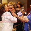 Lifetime Achievement Winner Katie Tyler gets a kiss from her friend at the Women in Business event.