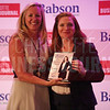 Cheryl RIchards of Northeastern University-Charlotte presents Melissa Gladder with her Women in Business award.