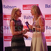 Cheryl RIchards of Northeastern University-Charlotte presents Hallie Kilmer Cornetta with her Women in Business award.