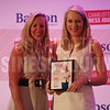 Cheryl RIchards of Northeastern University-Charlotte presents Melissa Breaux with her Women in Business award.