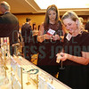 Vicky Pace of Business Wise and Carey Fissell of American Cancer Society shop for Kendra Scott jewelry at the Women in Business event.