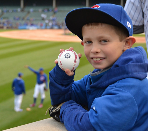 JP was fortunate enough to track down a foul ball and then one of the Cubs coaches was kind enough to give him a second batting practice ball.  Not a bad day at the ballpark.