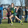 Nashoba's Kyle Cloutier kicks down the stretch at the end of the MIAA Div I Boys Cross Country Districts held at Gardner Municipal Golf Course. SENTINEL & ENTERPRISE / JIm Marabello