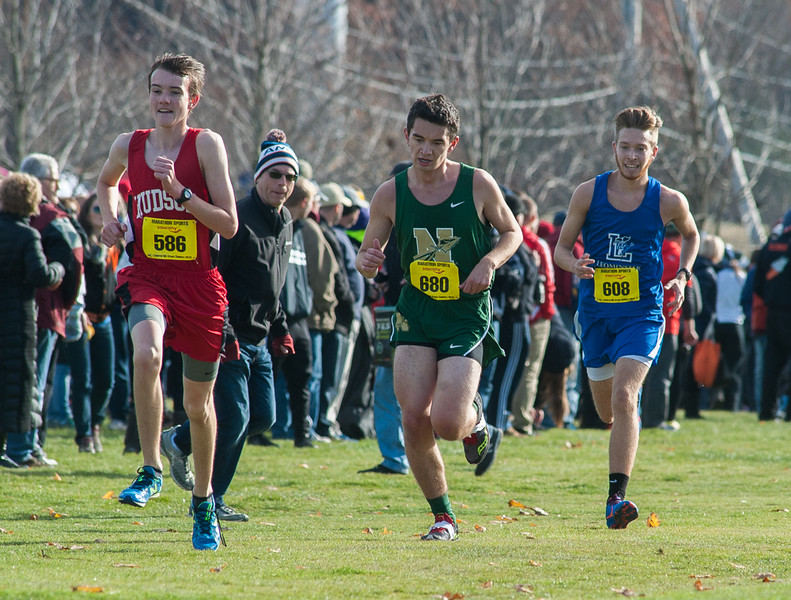 Nashoba's Matt Buttiglieri (680) and Leominster's Jacob Soulliere try and track down Hudson's Michael Cuddy down the stretch of the Div I Boys Cross Country Districts held at Gardner Municipal Golf Course. SENTINEL & ENTERPRISE / JIm Marabello