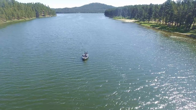 1-Fisherman and cruising Sheridan Lake
